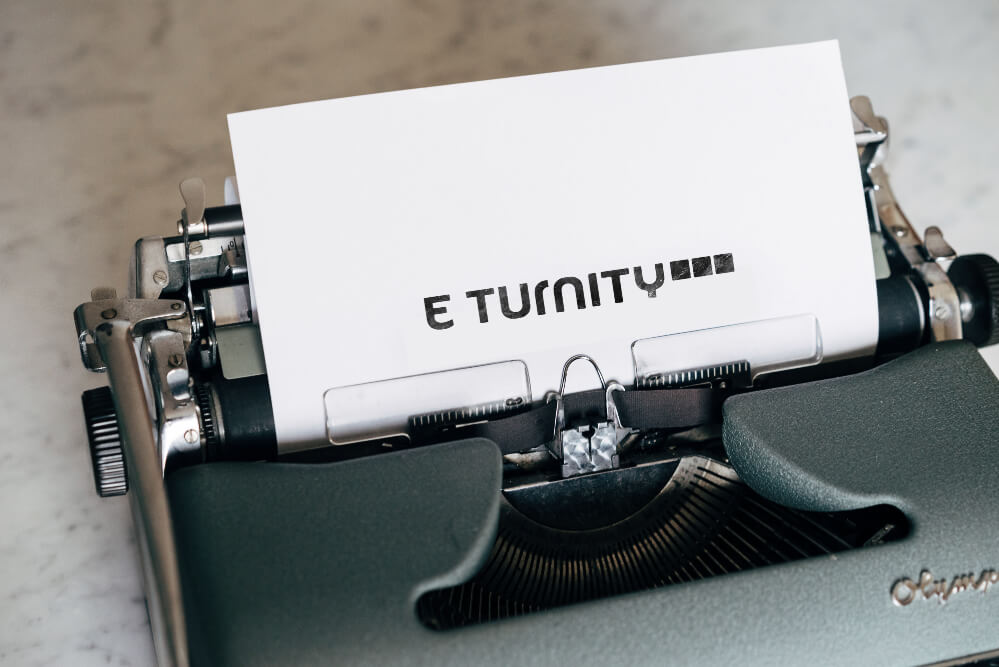 typewriter-with-paper-in-it-eturnity-logo-on-paper